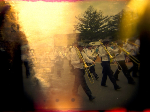 sun-damaged photo of a band in a parade