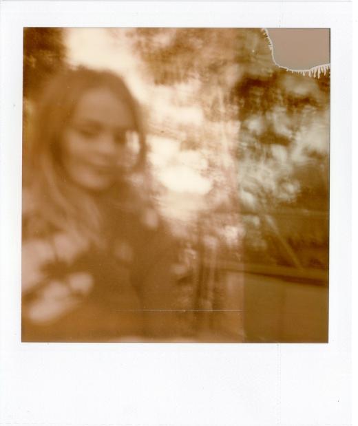 PX-100 Silve Shade Polaroid of a girl