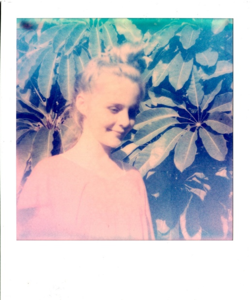 Polaroid of a girl using PX-70 PUSH